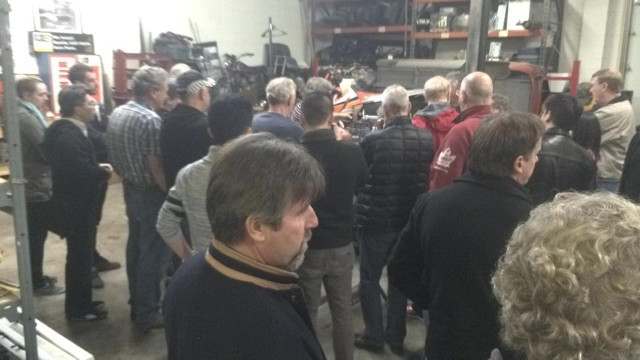 Motorsport enthusiasts attending the 2014 Formula Ford Open House watch a 20-minute transmission internals remove and install