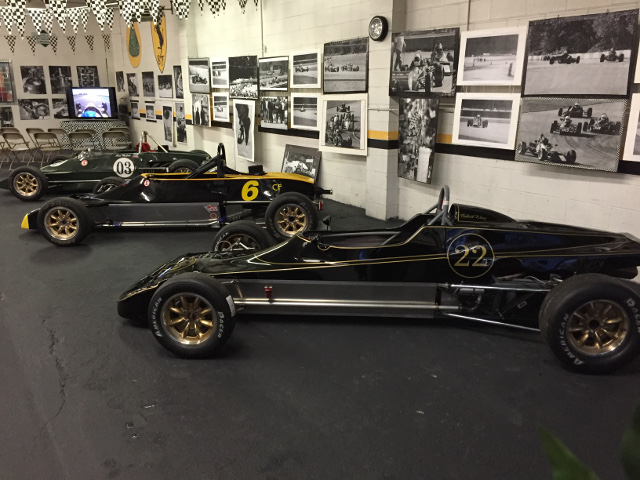 Plenty of wall art to accent the beautiful lines of the vintage Formula Ford racers